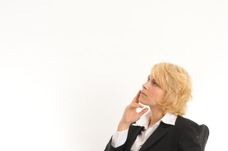 Young business woman thinking about problems and solutions.