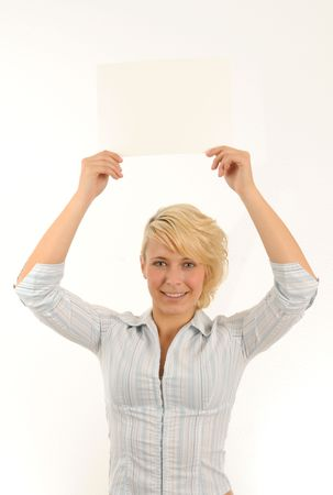 young woman holding a white card with both hands.Isolated over white.
