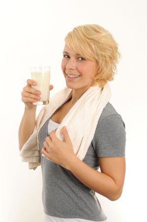 young woman is drinking a glass of milk.Isolated over white. Stock Photo