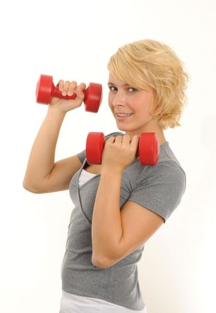 young woman doing exercise with two red dumbbell.