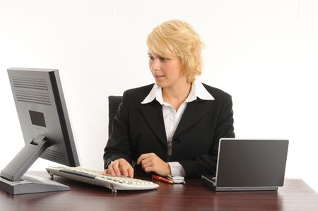 young business woman working in a modern office.Isolated over white.