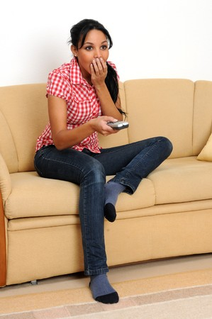 Young woman watching TV.