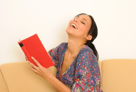 Laughing woman with book.