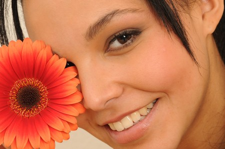 young woman with colorful flower
