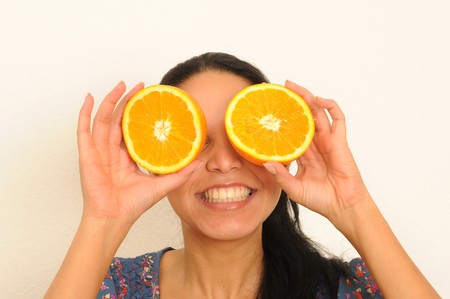 eating and enjoying fresh fruit. Stock Photo