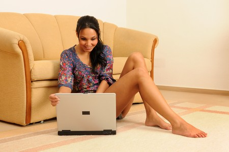young woman at home,working with her laptop. Stock Photo