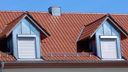 dormer: Red tile roof with dormers Stock Photo