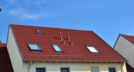 A red tile roof with skylights Stok Fotoğraf