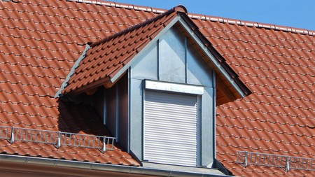 tile cladding: Red tile roof with dormers Stock Photo