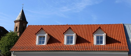 Red tile roof with dormers Stock Photo