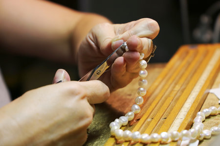 Threading a pearl necklace