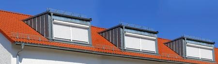 dormer: A red tile roof with dormer
