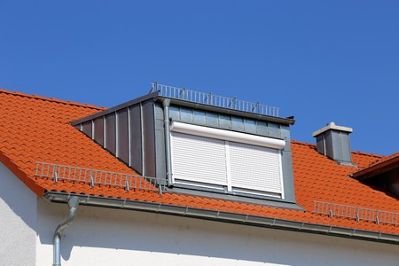 A red tile roof with dormer