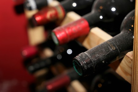 claret: Red wine bottles in wine vault Stock Photo