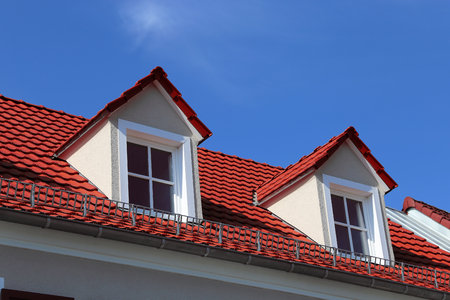 dormer: Red tile roof on a residential home with dormer