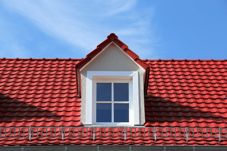 Red tile roof on a residential home with dormer