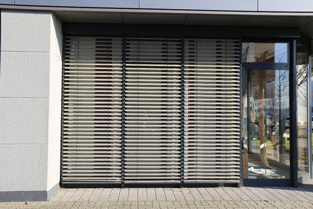 sun screen: Window with blind, exterior shot Stock Photo