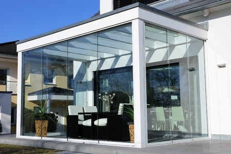 Residential home with conservatory, exterior shot