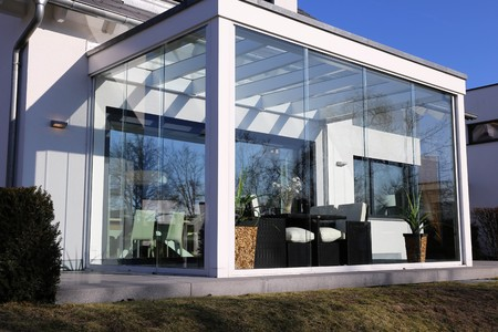 conservatory: Residential home with conservatory, exterior shot