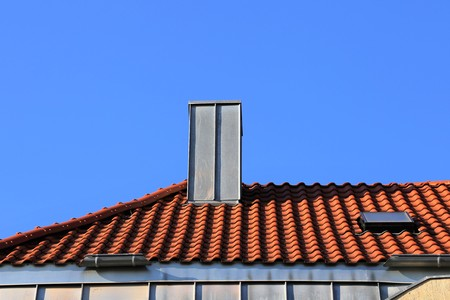 cladding: Chimney with stainless steel cladding Stock Photo