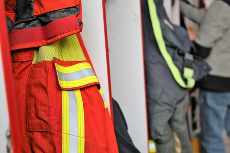 Firefighting clothing, in the background a fireman Stock Photo