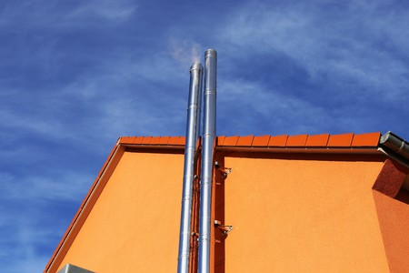 exhaust system: Stainless steel chimney on a new residential home
