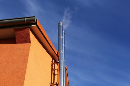 Stainless steel chimney on a new residential home