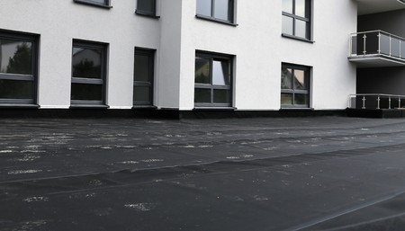 bitumen: Waterproofing flat roof with bitumen Stock Photo