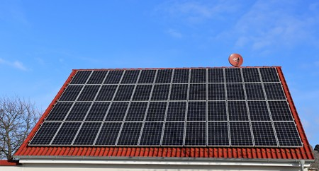 roofing system: Roof with solar panels Stock Photo