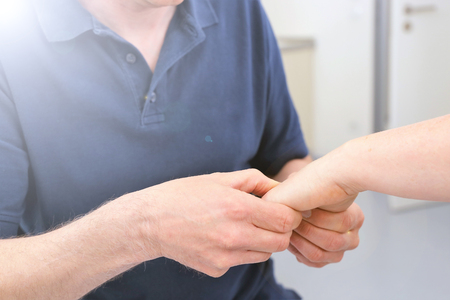 Orthopedist examine wrist