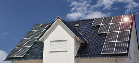 Roof with solar panels Stock Photo