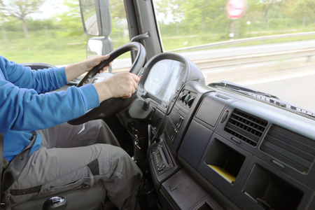 Truck driver on the road (interior shot) Stock Photo