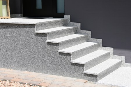 Staircase with solid block steps with stone chip render Фото со стока