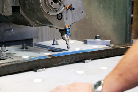 milling center: Metalwork with CNC milling machine Stock Photo