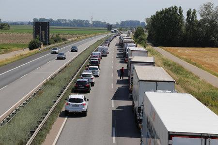 Traffic jam with rescue lane on german motorway (07/19/17, A 61 near Speyer, Rhineland-Palatinate)