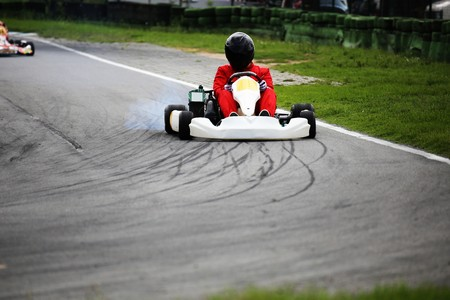 racetrack: Go-kart driver on the circuit