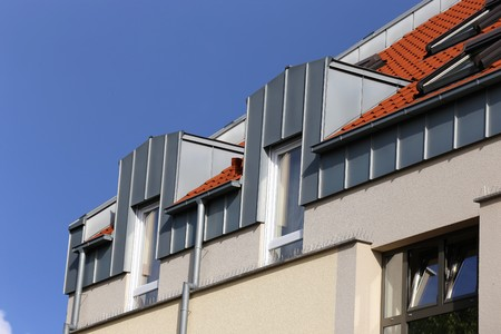 Dormer with stainless steel cladding