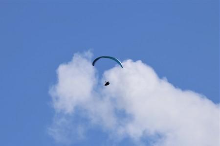 Paraglider against blue sky