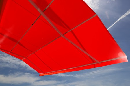 Awning against a blue sky