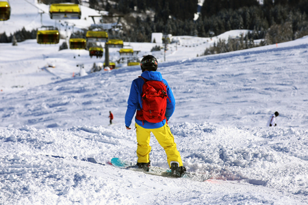 Snowboarder riding the slope Stock Photo
