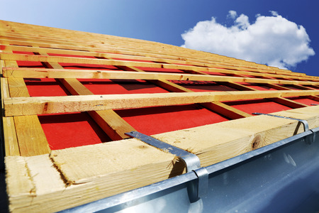 Tiling a roof Stock Photo