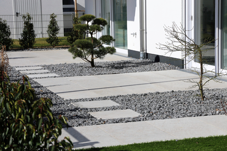 Modern decorative garden with gray terrace tiles