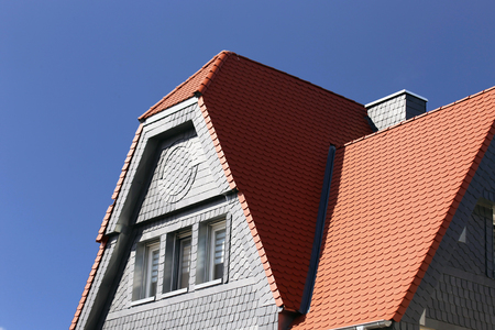 Red tile roof with slate plates