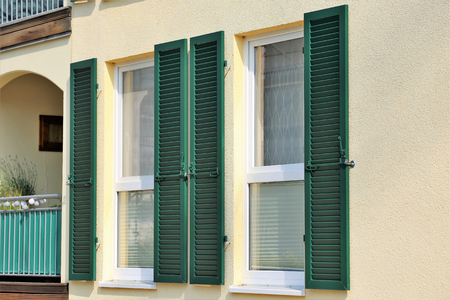 Window with wooden shutter, exterior shot Archivio Fotografico