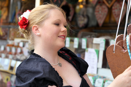 Woman with traditional german costume at a (fair) german Imagens - 104996381