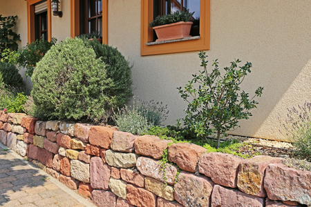 Front yard with dry stone wall, natural stone wall