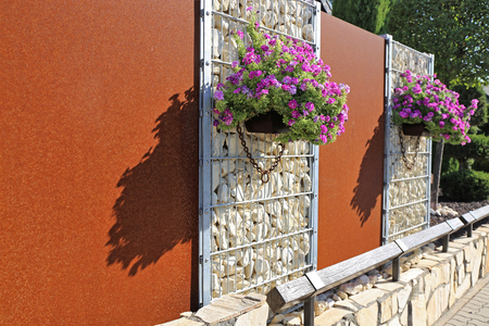 Gabion fence wall with flowers
