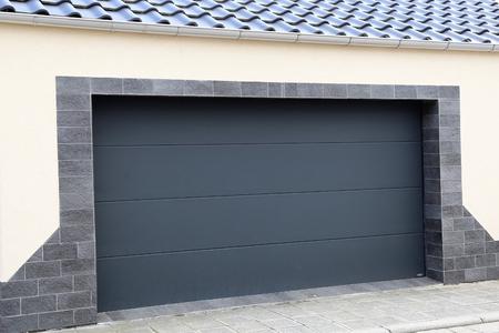 Modern new garage door (sectional door) Stock fotó
