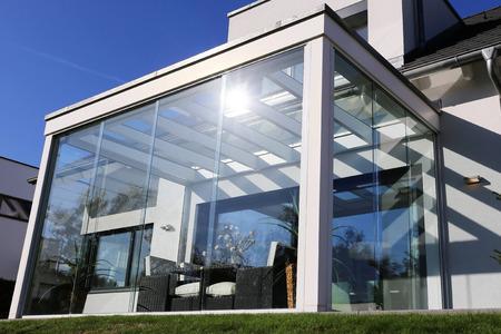 Residential home with modern winter garden, exterior shot