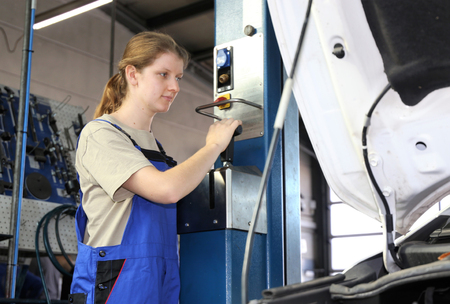 Woman in male-dominated profession: Car mechanic